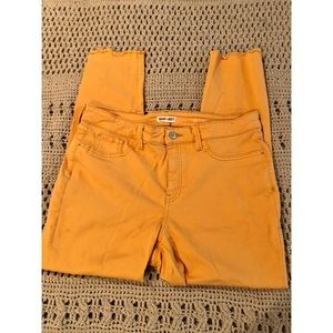 Stretchy mustard skinnies with a frayed edge